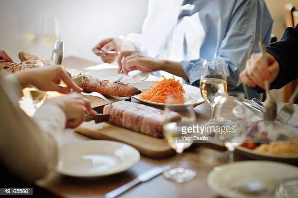 friends sharing a meal in the cafe in the early af - french food stock pictures, royalty-free photos & images