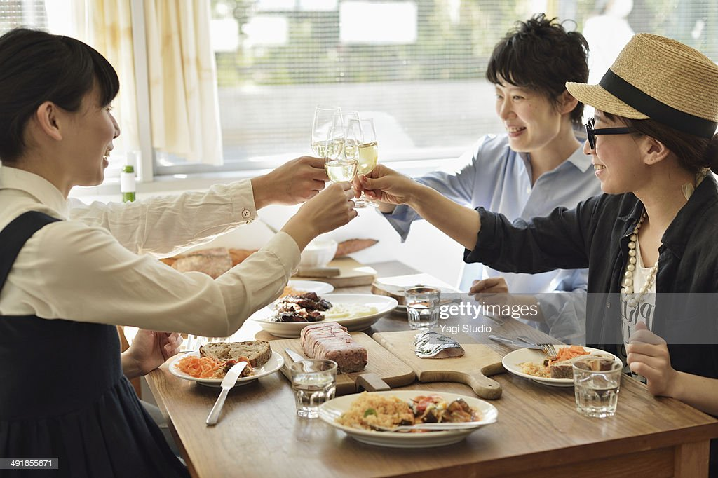 Friends sharing a meal in the cafe in the early af : Stock Photo