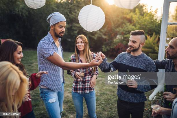 Friends sharing a smoke at a party