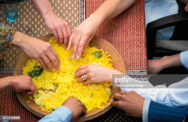 Friends Sharing Couscous