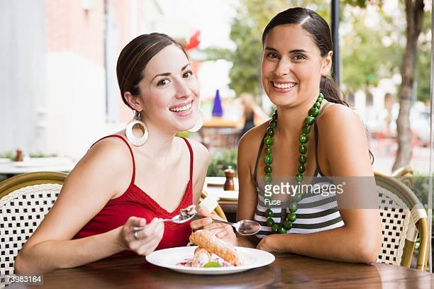 Friends sharing dessert