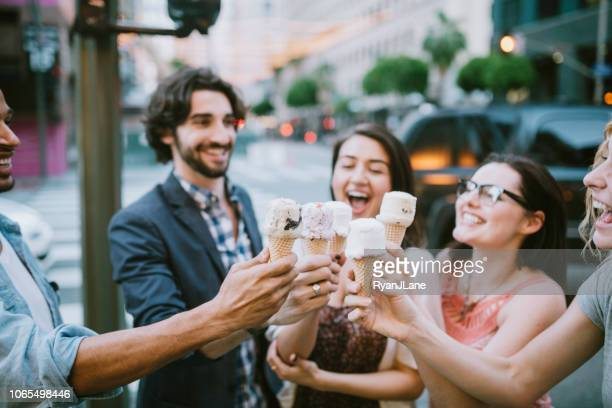 friends sharing ice cream cones in downtown la - ice cream stock pictures, royalty-free photos & images