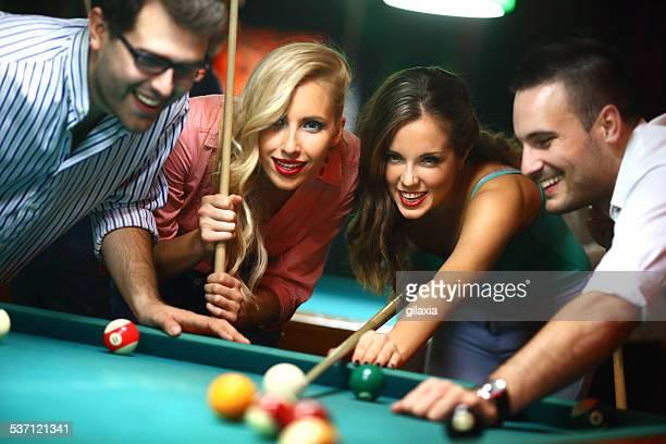Friends shooting pool.