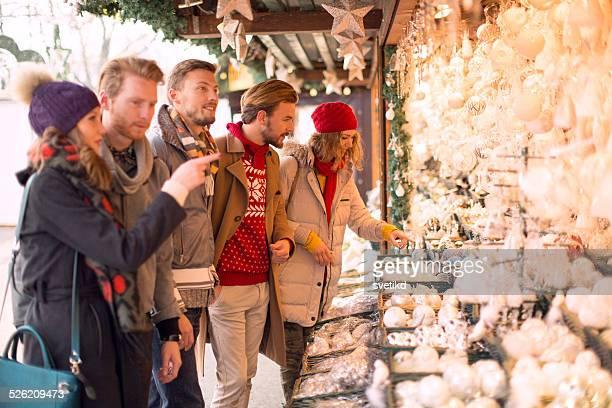 Friends shopping at christmas fair.