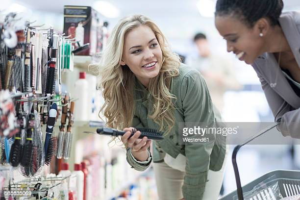 Friends shopping at drugstore