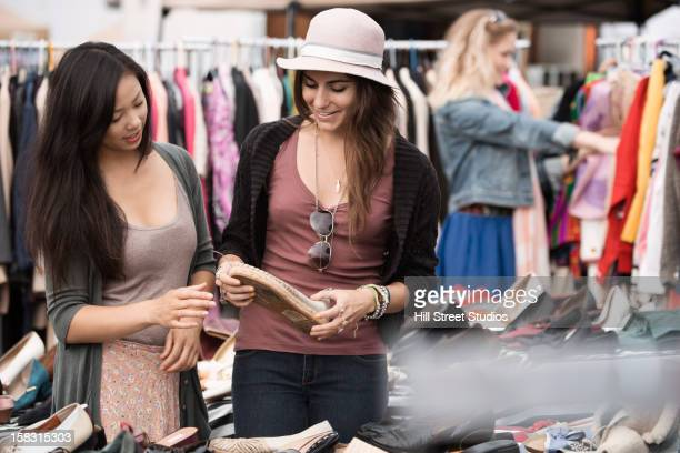 Friends shopping at flea market