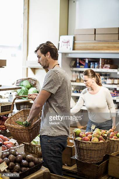 Friends shopping groceries in supermarket