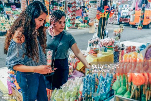 Friends shopping together in Market
