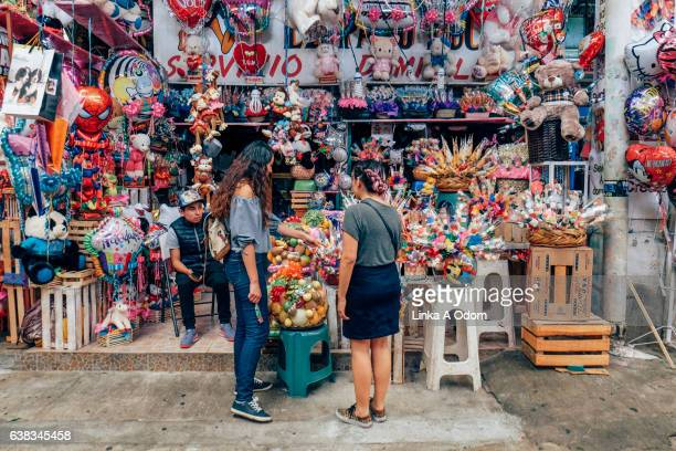 friends shopping together in market - mexico city stock pictures, royalty-free photos & images