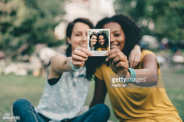 Friends showing instant photo