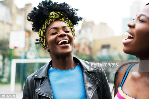 friends singing harmonies and laughing - candid stock pictures, royalty-free photos & images
