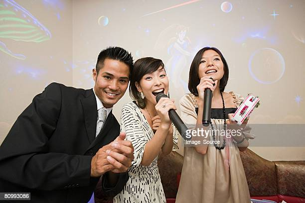 Friends singing karaoke