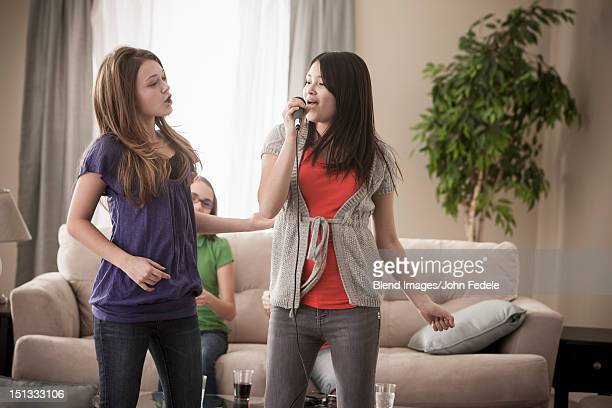 Friends singing karaoke together