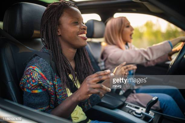 friends singing on a road trip - singing stock pictures, royalty-free photos & images