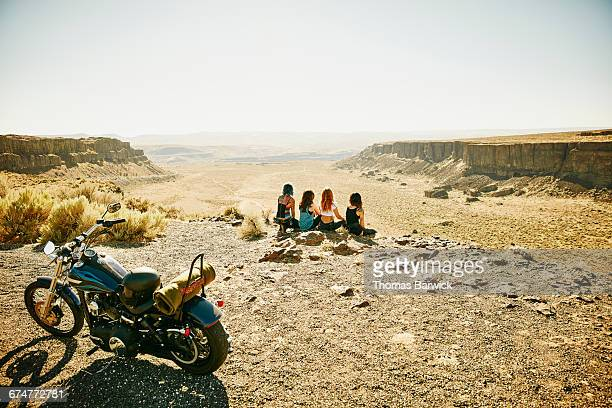 Friends sitting at overlook during road trip