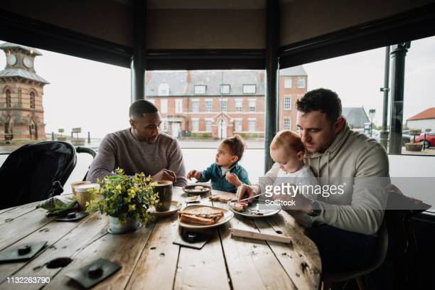 friends sitting in a cafe with their babies - responsibility stock pictures, royalty-free photos & images