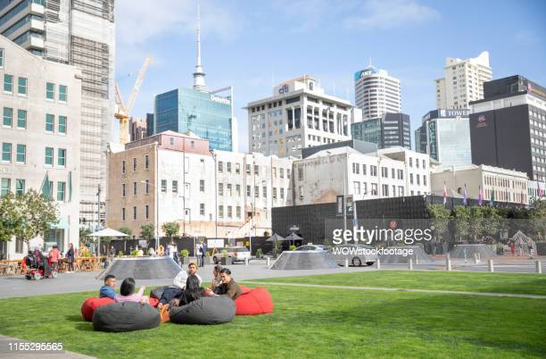 friends sitting in public downtown square - auckland stock pictures, royalty-free photos & images