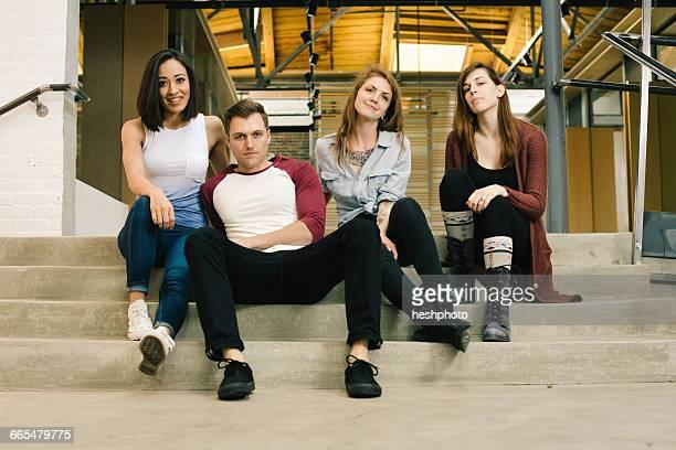 friends sitting on steps looking at camera - heshphoto - fotografias e filmes do acervo