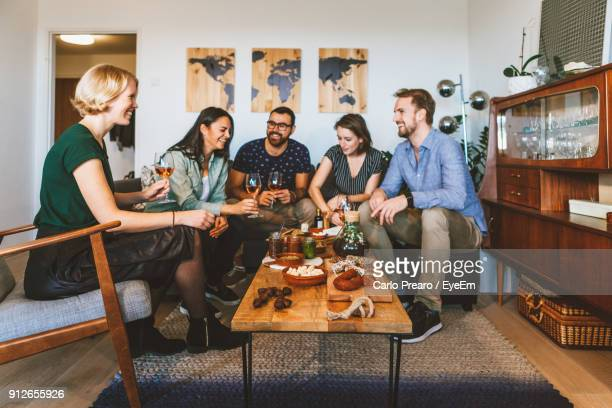 friends sitting on table at home - brunch stock pictures, royalty-free photos & images