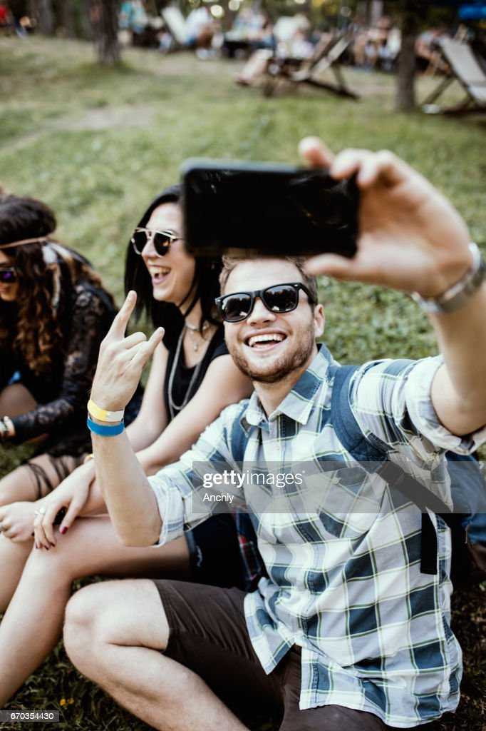 Friends Sitting On The Meadow Cute Guy Taking Selfie High Res Stock Photo Getty Images