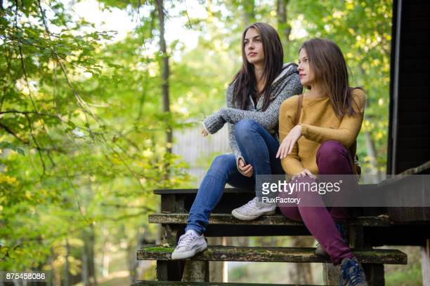 friends sitting on the stairs and talking - adults only stock pictures, royalty-free photos & images