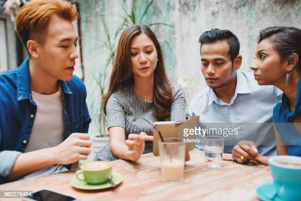 Friends sitting together in cafe kuala lumpur
