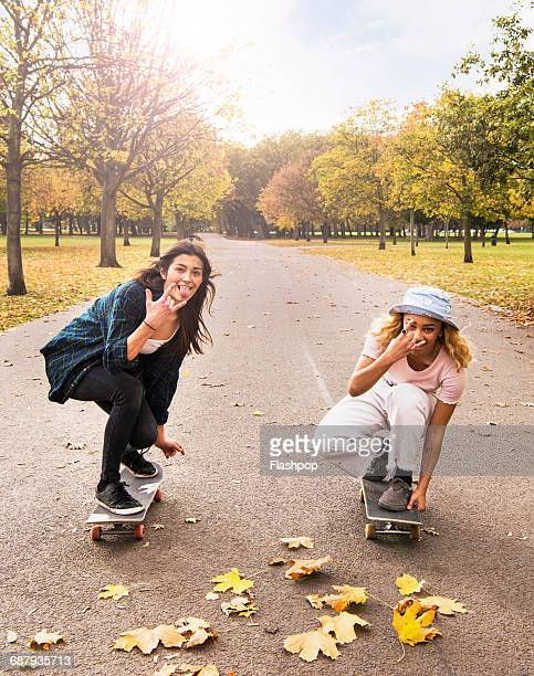 Friends skateboarding in a park
