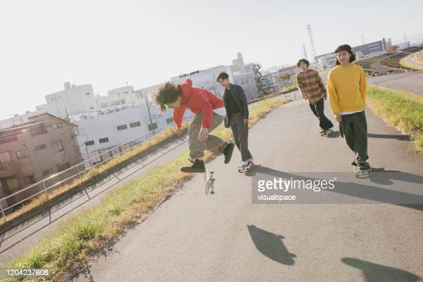 friends skateboarding - ollie pictures stock pictures, royalty-free photos & images