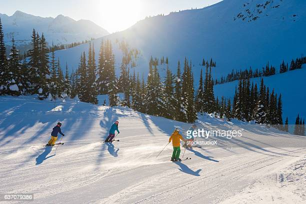 friends skiing on a sunny day - alpine skiing stock pictures, royalty-free photos & images