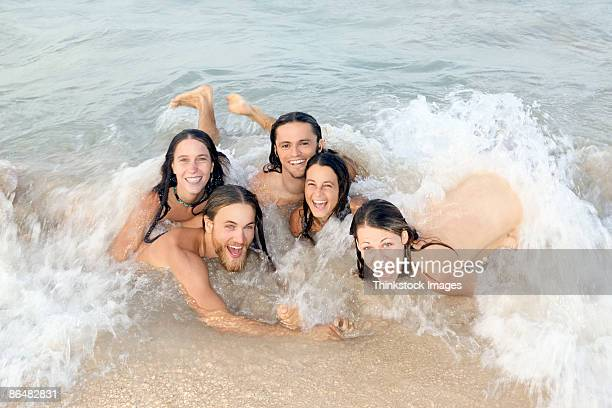 Friends skinny dipping in ocean
