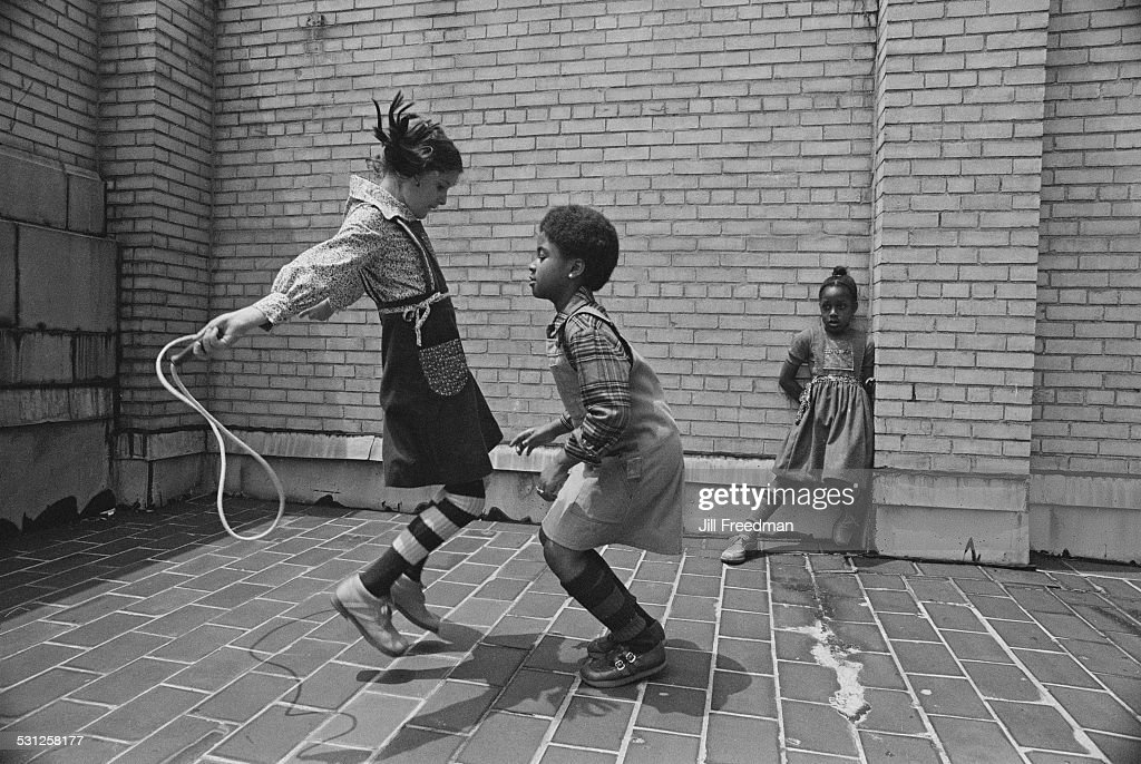 Friends skipping (jumping rope) in New York City, circa 1976.