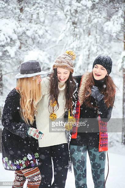 friends smiling in the winter nature