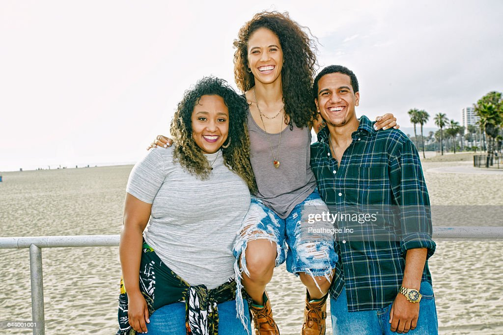 Friends smiling on beach : Stock Photo