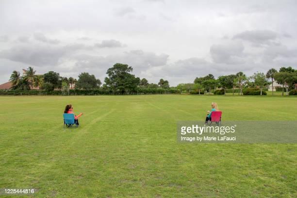 friends social distancing outdoors - メートル ストックフォトと画像
