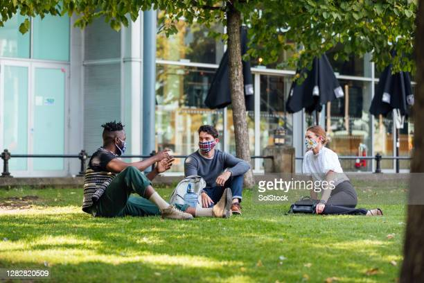 friends social distancing - group of people stock pictures, royalty-free photos & images