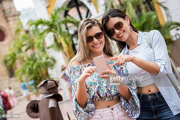 Friends social networking while sightseeing
