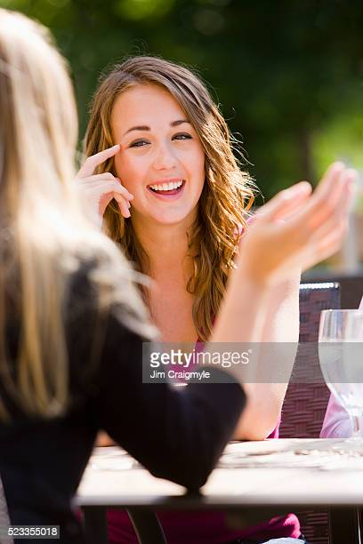friends socializing at cafe - jim craigmyle stock pictures, royalty-free photos & images