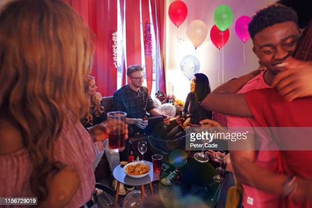 friends socializing at house party - house after party stock pictures, royalty-free photos & images