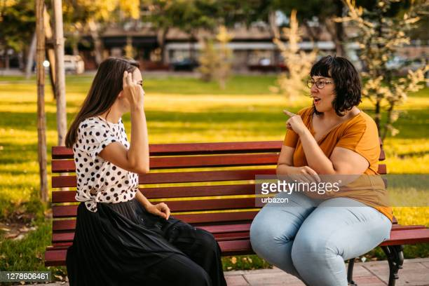 friends speak in sign language - sign stock pictures, royalty-free photos & images