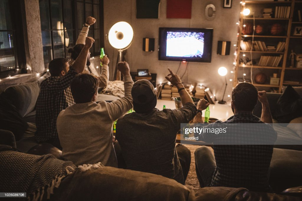 Friends spend weekend together watching TV : Stock Photo