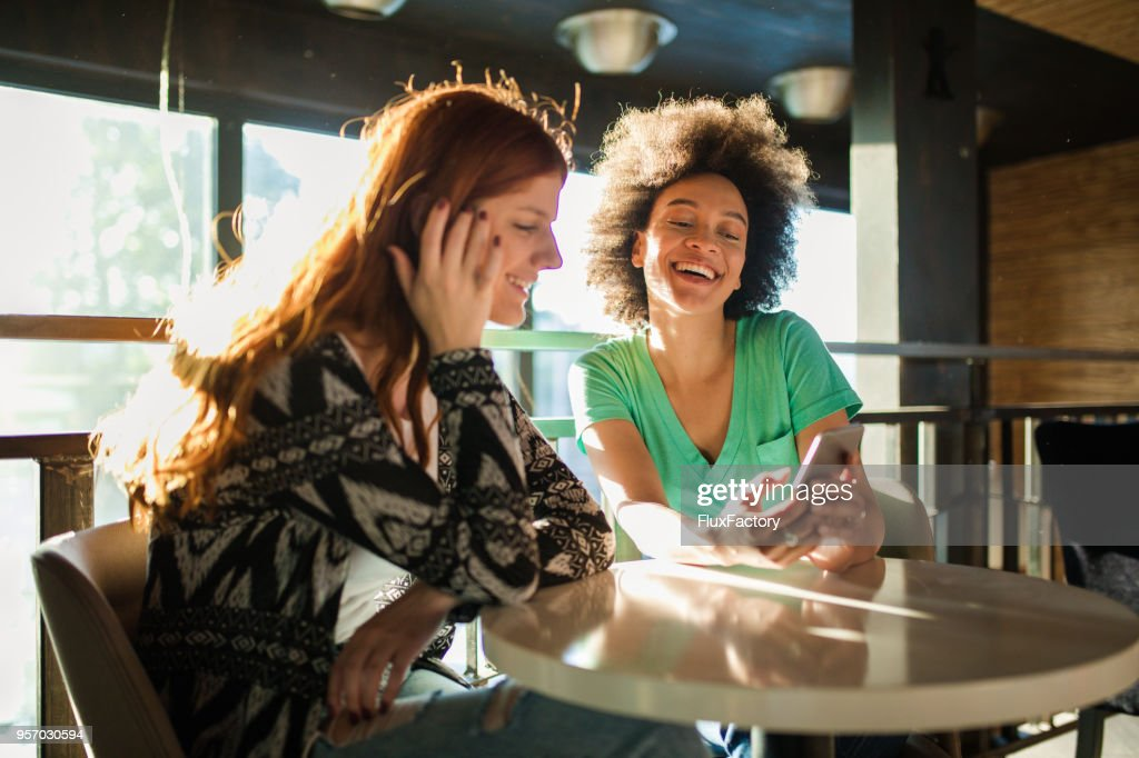 Friends spending time together at the cafe : Stock Photo