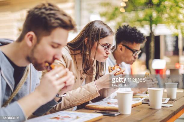 friends spending time together in the city - street food stock pictures, royalty-free photos & images