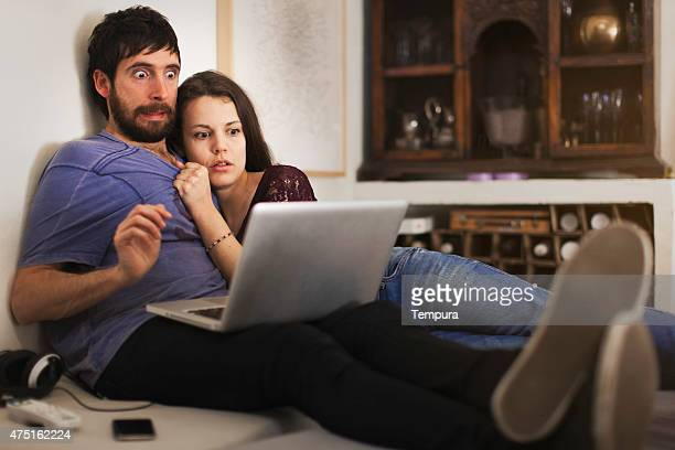 friends streaming with a laptop a horror film - scary movie stock photos and pictures