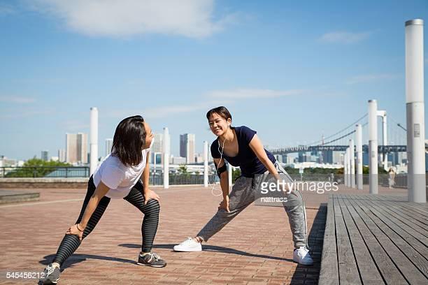 Friends stretch before run