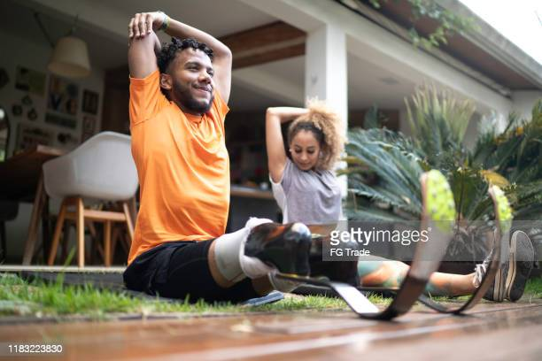 friends stretching in the yard - disabilitycollection stock pictures, royalty-free photos & images
