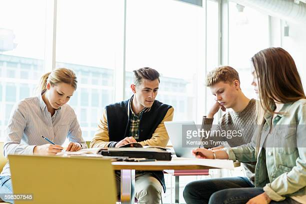 Friends studying in university classroom