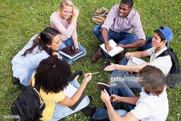 friends studying on grass - 18 19 years stock pictures, royalty-free photos & images