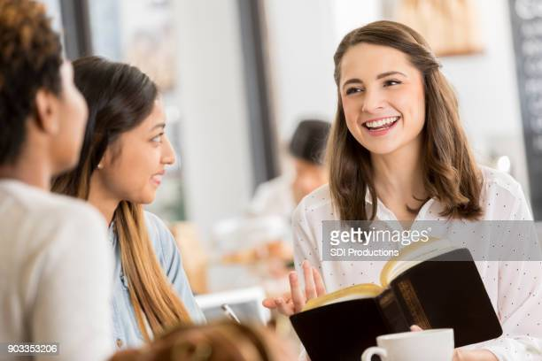 friends studying the bible together - christianity stock pictures, royalty-free photos & images