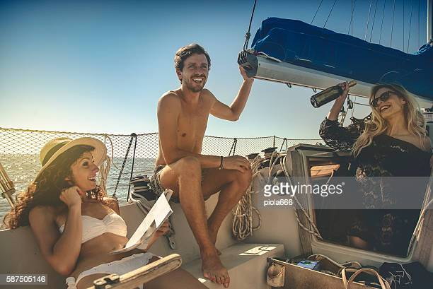 friends summer vacation: party on a sailing yacht - hot women on boats stock pictures, royalty-free photos & images