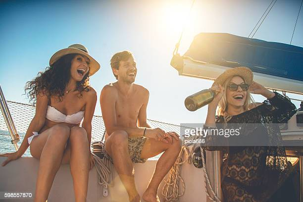 Friends summer vacation: party on a sailing yacht